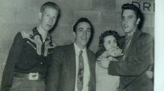 Jimmy Day (a steel guitar player of the Louisiana Hayride), Faron Young, Wanda Jackson and Elvis Presley are pictured backstage at the Denver Coliseum in Denver, Colorado. This photo was taken by Denver Coliseum employee George Kealiher, Jr. on Sunday, April 8, 1956. Elvis played two shows there at 3 pm and 8 pm. See another, previously unpublished photo here: https://www.pinterest.de/pin/380906080973703353/ For more info: http://www.scottymoore.net/denver.html