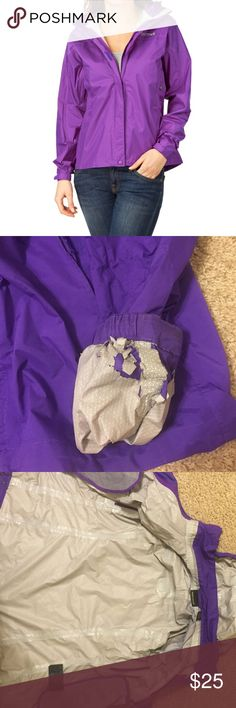 "Marmot Purple Rain Jacket/Windbreaker Water proof and great for windy days, this Marmot jacket has a hood, pockets on the sleeves, and standard front pockets. There is sign of wear on the left sleeve, as pictured above, with a bit of torn lining and some picking/ripping of fabric on the outside of that area. The Velcro fastenings do have some ""fluff"" & fabric attached to them due to wear but none of these imperfections are visible when wearing. Marmot Jackets & Coats"