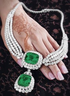 An emerald and diamond necklace, by Cartier. This piece features two large emeralds and carats) surrounded by 75 carats of diamonds.Via Diamonds in the Library. jewelry Cartier emerald and diamond necklace. Emerald Necklace, Emerald Jewelry, Emerald Gemstone, Diamond Jewelry, Pendant Necklace, Diamond Necklaces, Emerald Diamond, Emerald Rings, Ruby Pendant