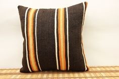 Traditional kilim pillow cover 16x16 inch (40x40 cm) Stripe Kilim pillow cover Sofa Decor Ethnic Pillow cover Accent Pillow Cover Cushion Cover. Turkish handmade Oriental kilim pillow cover By Kilimwarehouse Size: 16x16 Inches / 40x40 Cm Front side: Vintage Handmade kilim rug, material wool & cotton. Back side: Cotton fabric and hidden zipper. Pillow insert is not included. Only Dry clean. Please note that colors may vary slightly on different computer monitors. Shipment: Fedex worldwide...