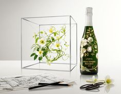 "Perrier-Jouët Belle Epoque Florale by Makoto Azuma     ""The delicate anemones that decorate the bottle chosen by Gallé embody the elegance of the brand and celebrate Japanese art that is closely linked to the art of floral composition. Makoto Azuma created a three-dimensional frame where flowers are suspended like some fantastical hanging garden where white and green command his composition and yellow completes the harmony."""