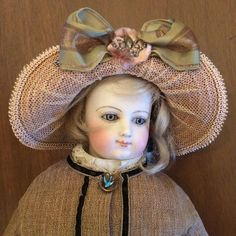 "A lovely 17"" French Poupee fashion lady from the 1800s.  She has a bisque swivel-head that fits into a bisque shoulder plate.  Her grey-blue glass"