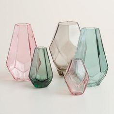 In muted hues, our vases come in multiple sizes and make a charming gift or decorative display. Arrange these jewel-like vases on your mantel or tabletop.