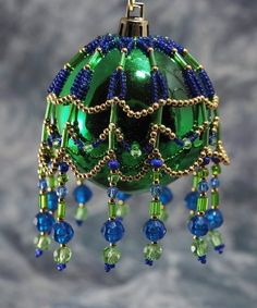 Sparkling Beaded Ornament Cover to dress up any standard or smaller size Christmas ball ornament. All covers are hand-beaded using quality glass Beaded Christmas Decorations, Christmas Ornament Crafts, Handmade Christmas, Christmas Tree Ornaments, Beaded Ornament Covers, Beaded Ornaments, Helmet, Wire, Wedding Supplies