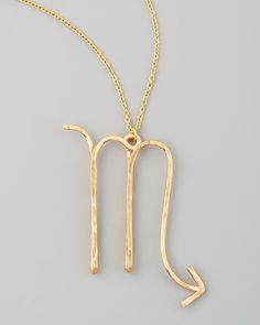 Details This stylish zodiac necklace features a 2-inch long Scorpio astrological sign pendant (October 23-November 21) in 14-karat gold fill or sterling silver. The delicate cable chain zodiac necklac