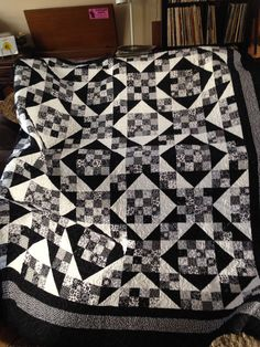 Just got it back from the quilt shop!! Love it!! Black and white Jacob ladder quilt!