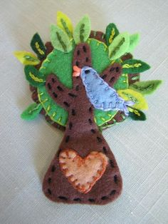 Tree pin with bird