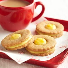 Orange-Ginger Cookie Sandwiches; A round cookie cutter with scalloped edges makes a nice shape for these cookies, but bell, tree or star cutters would also be good choices for the holidays.