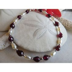 Faceted teardrop garnet bracelet, Garnet bracelet, Pearl bracelet,... (€27) via Polyvore featuring jewelry, bracelets, pearl bangles, white jewelry, garnet jewellery, birthstone jewelry and red bangles