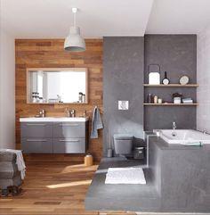 Une salle de bains moderne entre bois et béton ciré