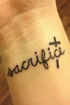Wrist tattoo - sacrifice & cross