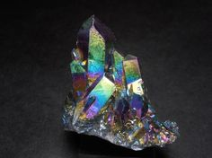 Titanium Aura Infused Quartz Crystal has a high energy and is helpful for removing energy blockages, especially those impeding creativity. Titanium Aura Quartz, Quartz Crystal, Rainbow Colors, Minerals, Amethyst, High Energy, Gemstones, Texture, Rock