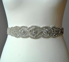 Sophisticated and elegant bridal belt. This is unique luzury bridal belt with large rhinestone crystal applique. Fully encrusted with silver