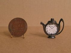 teapot clock - can choose color, style of clock face, time, etc.  $6.50T