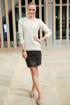 Rock a beige knit jumper with a black leather mini skirt for a standout ensemble. Nude leopard leather ballerina shoes are a perfect choice to complete the look.  Shop this look for $31:  http://lookastic.com/women/looks/beige-leather-ballerina-shoes-black-leather-mini-skirt-beige-cable-sweater/5107  — Beige Leopard Leather Ballerina Shoes  — Black Leather Mini Skirt  — Beige Cable Sweater