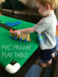DIY PVC Frame Play Table - Portable, storable, slides or folds away! Great for small spaces and apartments or for travel. Use it with trains, LEGO, cars, animals and felt board pieces. On Lalymom.com
