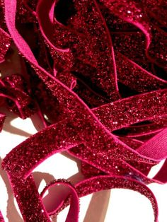 """Hot pink 3/8"""" frosted glitter elastic. For making baby headbands, barefoot baby sandals, sewing & more. FOE, shabby rose trim, jewelry findings & more also available!"""