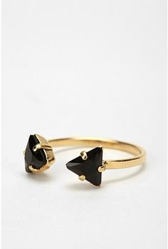 Viveka Bergstrom Triangle Ring  $71.00  Forever21 sells a knockoff with brown gems for $4