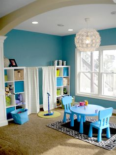 Tension Rod Uses - I like this example of using a tension rod between shelving unites in a playroom to hang curtains for a stage