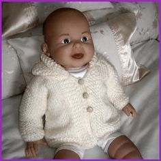 Measurements To fit: 12 months Chest: 22 inches (56 cm) Length: 10 inches (25.5 cm) Materials King Cole Big Value Chunky Shade: 551 Cream, 200 g A pair of 6½ mm (US 10.5) knitting Needles 3 buttons…