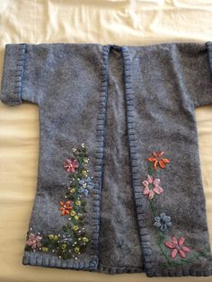The completed jacket for the doll in pattern