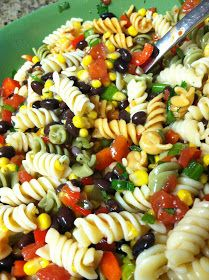 BLACK BEAN & CORN PASTA SALAD 1 (16-ounce) box rotini tri-colored pasta, cooked  2 cans black beans rinsed and drained well 1 small bag frozen corn, thawed 1 can Rotel 4 green onions, chopped ½ cup bell pepper, chopped ½ cup white onion, chopped 2-3 Tablespoons fresh cilantro chopped ¾ of a  large bottle of Zesty Italian dressing Mix all together and refrigerate at least 2 hours.