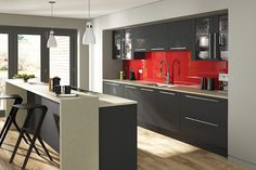 dont be fooled by the quiet tones of graphite add a dash of originality with a sparkling red splash back and see how bold a design you can create - Cuisine Grise Et Rouge