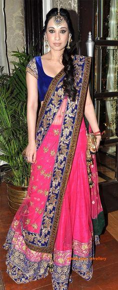 Maang tikka. Blue velvet and pink lehnga by Manish Malhotra