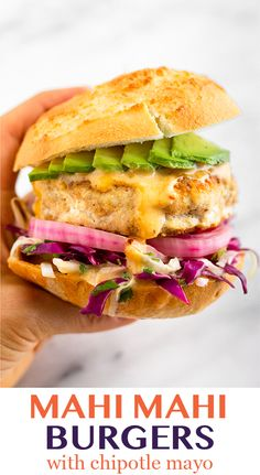 Taco inspired Mahi Mahi Burgers made with fresh Mahi Mahi, taco seasoning, almond flour, and an egg - then pan fried for the perfect golden brown juicy fish burger. Topped with a cabbage slaw, pickled Burger Toppings, Burger Recipes, Seafood Recipes, Paleo Recipes, Cooking Recipes, Gourmet Burgers, Fish Sandwich, Chipotle Mayo, Recipes