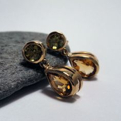 One of our favourite styles. Double oval studs great fun colours and easy to wear. Peridot and citrine drop earrings. Citrine Earrings, Stud Earrings, Ear Studs, Diamond Studs, Peridot, Jewelry Collection, Cufflinks, Silver, Gold