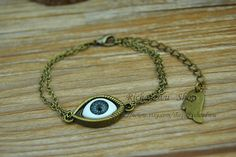 Mysterious eyeball charm braceletRetro bronze eye by Richardwu, $2.50