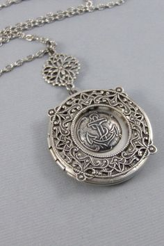Potentially how Marella's locket would look but with a starfish across the anchor. Navy Mom, Silver Lockets, Pocket Watch, Antique Silver, Anchor, Pendant Necklace, Jewels, Chain, Trending Outfits
