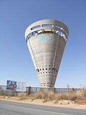 File:Johhanesburg Water-Midrand Tower-One of the most notable features of Midrand, Johannesburg, the Joburg Water water tower next to Grand Central Airport. South Africa Safari, Safari Holidays, Tower Building, Gallon Of Water, Concrete Structure, Water Tower, Water Supply, Brutalist, Africa Travel