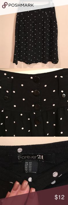 Forever 21 Skirt Gently worn, good condition. Minor signs of wash and wear. Light weight. High waisted. Says size XS but fits like a S. Adorable button down detailing. Length Top to bottom is 24 inches. Forever 21 Skirts Midi