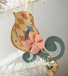 Splashy papers, fun embellishments, and a hint of glitter decorate these preening bird ornaments, a great way to refresh your Christmas tree decor.