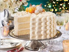 Snowy Vanilla Cake with Cream Cheese Buttercream Recipe | The Big White Cake has been a tradition at Southern Living since 1995. Each year, our readers (as well as the staff) eagerly anticipate the December issue, anxious to bake and enjoy this show-stopping dessert. This year's fabulous cake really raises the bar; not only is it incredibly delicious, but the eye-catching Cake Ball Ornaments make it almost too pretty to eat. Cake flour, egg whites, and a generous amount of vanilla extract…