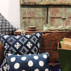 Indigo dyed block printed cushions with old green Indian palace doors and celadon tea set from Japan | Walter G Textiles