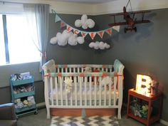 This is our nursery for our baby boy, Beckett! We had a blast finding all of the vintage travel treasures to inspire him to see the world! Orange, turquoise and gray.