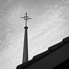 Steeple Cross on steeple at St John's Lutheran Church. Salisbury, NC  This image is to be printed on Ilford Professional True Black and White photographic silver gelatin paper- matte finish to last a lifetime.  Available at various sizes (See gallery home page) Framing or mounting options available.