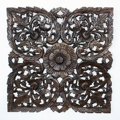 @Overstock - This piece features a detailed carving of the Lotus theme in a smaller square size. Several recycled rough-hewn teak planks from old dwellings and community buildings are joined together and then carved as a single unit.http://www.overstock.com/Worldstock-Fair-Trade/Black-Carved-Inlay-Square-Lotus-Panel-Thailand/7396382/product.html?CID=214117 $99.99
