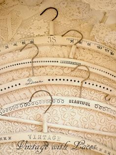 Vintage Clothes Hangers - painted white - distressed - stamped with text and patterns ~ so fabulous Julia!