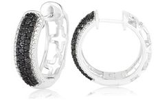These beautiful hoop earrings are made of sterling silver and feature a full carat of sultry black diamond. These beauties can be found in one of our 22 oz luxury Jewelry Candles they retail at $1300.00 how exciting!!! www.sweetsmellsntrinkets.com