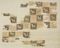 Fragments of a Wood-Block Print, 1000s - 1100s  Iran or Iraq, Seljuk period, 11th - 12th century  block printing on tabby; silk warp and cotton weft, Overall - h:32.10 w:40.00 cm (h:12 5/8 w:15 11/16 inches). John L. Severance Fund 1950.558. Cleveland Museum of Art.