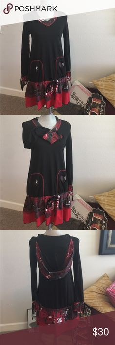 Moka Sport dress....in excellent condition. EUC Simply stunning. The dress is from Moka Sport. This is in excellent condition. This is FULL of design details and style. The hooded dress is a size Small Moka Sport Dresses