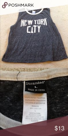 """Gray """"New York City"""" tank This is cute to layer or to wear on its own! It has no holes or stains, it comes from a smoke free environment! I ship Monday-Friday. """"No trades, holds, or modeling. And no sales outside poshmark."""" Price is firm Stranded Tops Tank Tops"""