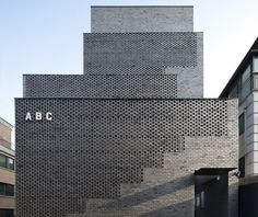 Perforated brick stairwells front Sensible Architecture's ABC workplace block | Architect Lover