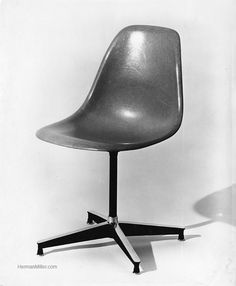 This chair features the earliest solid cast aluminum base developed by Charles and Ray Eames.  It was introduced in 1954 by Herman Miller.  Later it was applied by Charles and Ray Eames as the base for the 1956 671 Ottoman.