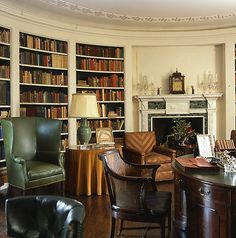 Oval library in the Manor House at Ladew Gardens - love the mossy green leather wingback and canary yellow silk table cover