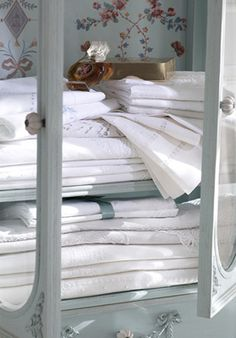 Beautiful white linens, & I adore the linen cabinet, as well~❥
