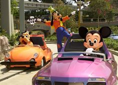 Mickey and Pluto having a race at Autotopia.